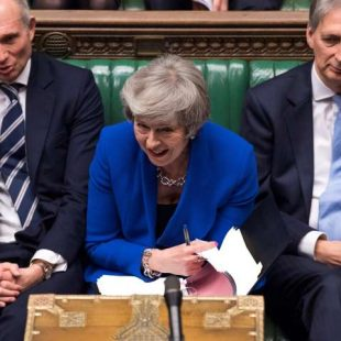 May's government survives no-confidence vote after Brexit defeat
